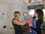 Baby arriving and being welcomed by key worker at Hugo and Holly Nursery