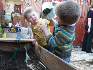 Gardening at Hugo and Holly Nursery, Brunswick Square, Gloucester