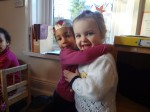 Toddler greeting a friend at Hugo and Holly Nursery