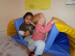Toddlers playing with the soft gym equipment at Hugo and Holly Nursery