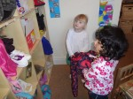 Pre school helping each other to find a place for their belongings at Hugo and Holly Nursery