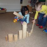 Pre school children building together